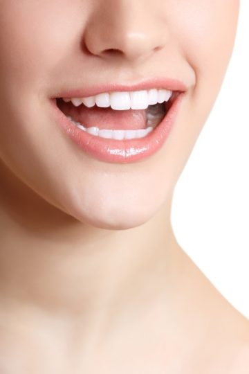 Perfect smile of beautiful woman with great healthy white teeth. Isolated over white background